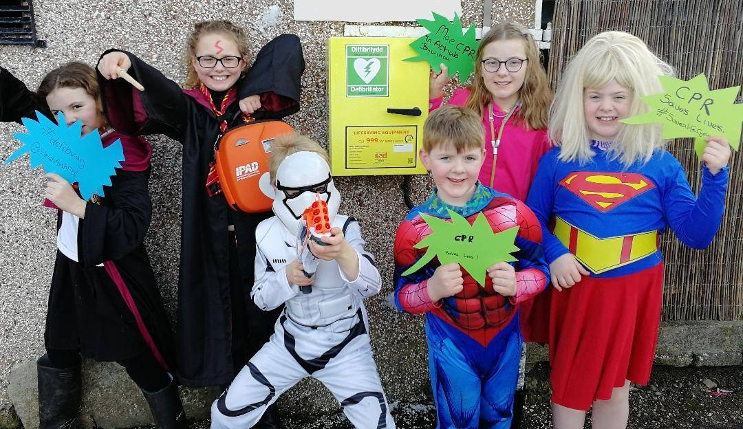 Super Heroes checking their defib