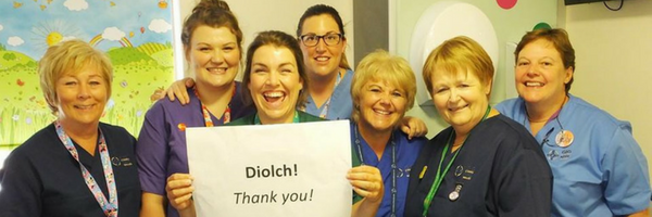 Picture of nursing staff holding up a thank you banner